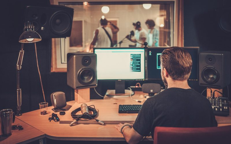 Music band during cd recording in studio