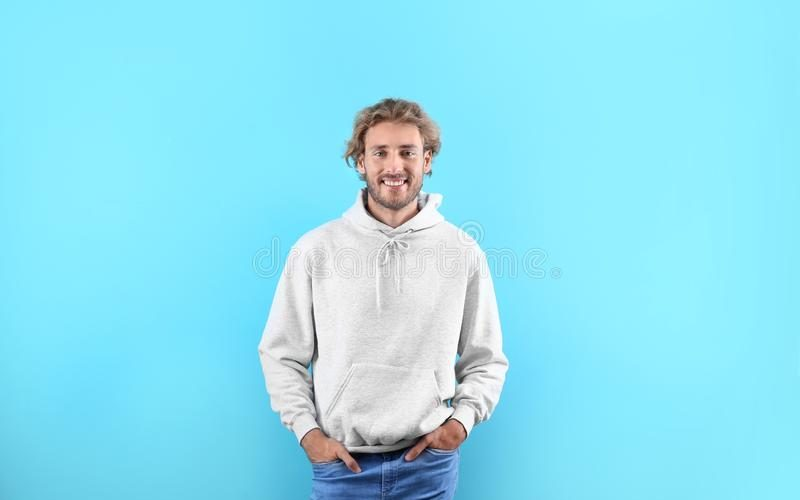 portrait-man-hoodie-sweater-color-background-space-design-portrait-man-hoodie-sweater-color-background-space-127822235